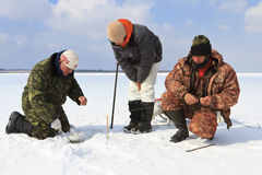 Ice Fishing. Winter fishing. Fishing for fish from the hole stock photos