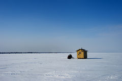 Ice fishing. An ice fishing shelter on a frozen mountain lake Royalty Free Stock Image