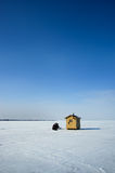 Ice fishing. An ice fishing shelter on a frozen mountain lake Royalty Free Stock Photos