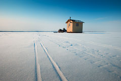 Ice fishing. An ice fishing shelter on a frozen mountain lake Royalty Free Stock Images