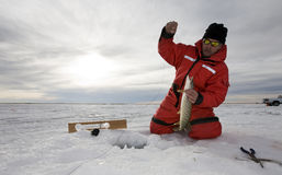 Ice fishing stock photo