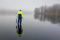 Ice fishing angler with reflection Stock Photography