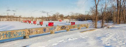 Ice Fishing cabins. In a vast spaces on the frozen Rivière des Mille Îles in Ste-Rose, Laval, Quebec, Canada Stock Image