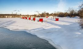 Ice Fishing cabins. In a vast spaces on the frozen Rivière des Mille Îles in Ste-Rose, Laval, Quebec, Canada Royalty Free Stock Photo