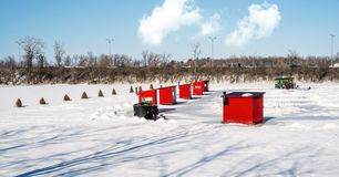 Ice Fishing cabins. In a vast spaces on the frozen Rivière des Mille Îles in Ste-Rose, Laval, Quebec, Canada royalty free stock photos