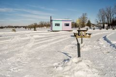 Ice Fishing Cabins and Picnic tables in Ste-Rose Laval. Ice Fishing cabins in a vast spaces on the frozen Rivière des Mille Îles in Ste-Rose, Laval, Quebec Stock Photos