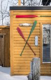 Canoe Oars on a wood cabin. Ice Fishing cabins reception Rivière des Mille Îles in Ste-Rose, Laval, Quebec, Canada Royalty Free Stock Photography