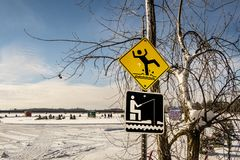 Ice Fishing Cabins and Signs scene in Ste-Rose Laval. Ice Fishing cabins and signs in a vast spaces on the frozen Rivière des Mille Îles in Ste-Rose, Laval Royalty Free Stock Photos