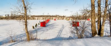 Ice Fishing cabins. In a vast spaces on the frozen Rivière des Mille Îles in Ste-Rose, Laval, Quebec, Canada Stock Photos
