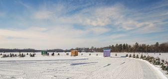 Ice Fishing in Ste-Rose Laval. Ice Fishing cabins in a vast spaces on the frozen Rivière des Mille Îles in Ste-Rose, Laval, Quebec, Canada Stock Photo