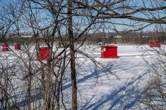 Ice Fishing cabins. In a vast spaces on the frozen Rivière des Mille Îles in Ste-Rose, Laval, Quebec, Canada stock photography