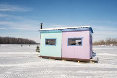 Ice Fishing Cabins in Ste-Rose Laval. Ice Fishing cabins in a vast spaces on the frozen Rivière des Mille Îles in Ste-Rose, Laval, Quebec, Canada Royalty Free Stock Photos