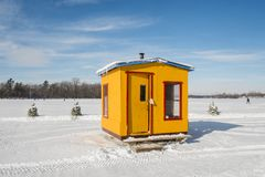 Yellow Ice Fishing Cabins in Ste-Rose Laval. Ice Fishing cabins in a vast spaces on the frozen Rivière des Mille Îles in Ste-Rose, Laval, Quebec, Canada Royalty Free Stock Images