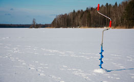 Ice fishing drill. Drilled down in the ice Stock Photography