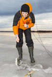 Ice fishing in the early morning. Stock Photos