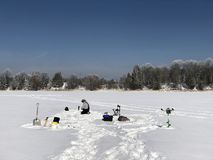 Ice fishing on a frosty morning Stock Photo