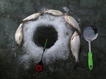 Ice fishing frozen hole ice background. Day light Stock Images