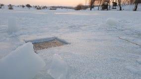 Ice fishing hole Stock Photos