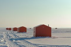 Free Ice Fishing Huts On A Frozen Lake In Ontario At Sunset Stock Images - 121516924