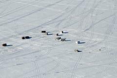 Ice fishing Lake Altoona Wisconsin. Ice shacks, fisherman and vehicles with tracks on Lake Altoona in Wisconsin for ice fishing Stock Photography