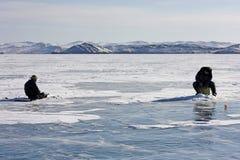 Ice fishing on Lake Baikal in the winter. royalty free stock image