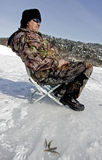 Ice fishing on a lake Stock Images