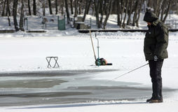 Ice fishing on a lake Royalty Free Stock Images