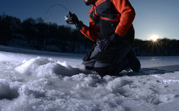 Ice fishing on a lake in winter Royalty Free Stock Photography