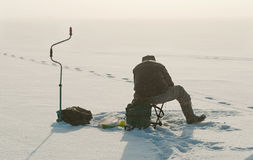 Ice fishing on the lake. Royalty Free Stock Images