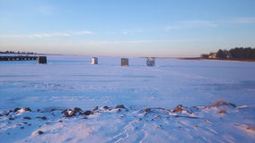 Ice Fishing. New brunswick, Canada, Acadian tradition, Maritimes, winter fun, twilight, fishing huts, chill sports, outdoor fun Stock Images