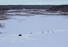 Ice fishing in north Saskatchewan. A view of ice fishers  in the north Saskatchewan Royalty Free Stock Image