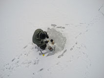 Ice fishing. Professional fisherman do ice fishing. He has ice drill and sonar Royalty Free Stock Images