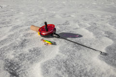 Ice fishing rod and lure Royalty Free Stock Image
