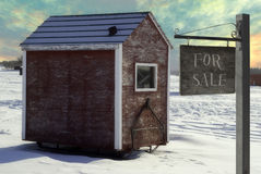 Ice Fishing Shed. An ice fishing shed is for sale with a sign saying so Stock Photo
