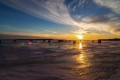 Ice Fishing at Sunset Stock Photo