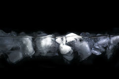 Ice. Floating in water. Water line visible. Focus concentrated on the lit area, drops off at the edges Stock Image