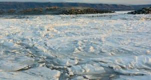 Ice Floe Behind Gravel Bar Royalty Free Stock Photos