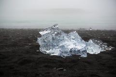 Ice floe on the black volcanic sand beach, Iceland Stock Photos
