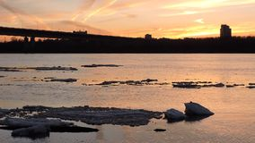 Ice floe floats in water, fragments of ice on the river in spring, ice drift stock video