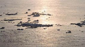 Ice floe floats in water, fragments of ice on the river in spring, ice drift stock footage