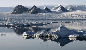 Ice floe resembling mountains. In the background Royalty Free Stock Image