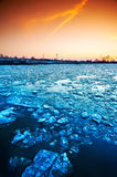 Ice floe on a river. Sunset in spring. Stock Photography