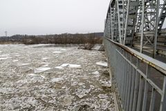 Ice floe on the river in winter, Puławy, Poland, 02.2012. Ice floe on the river in winter, bridge, wintern stock image