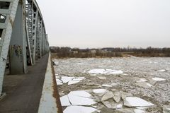 Ice floe on the river in winter, Puławy, Poland, 02.2012. Ice floe on the river in winter, wintern, thick sheets of ice, ice mountains, bridge stock photo