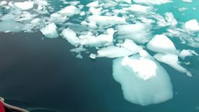 Ice floe and rubber boat in ocean of Antarctica. stock footage