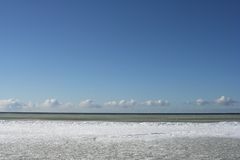 Ice floe on sea with blue sky Stock Image