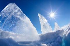 Ice floe and sun on winter Baikal lake Royalty Free Stock Photos