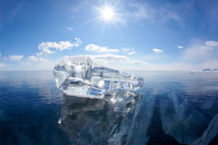 Ice floe and sun on winter Baikal lake. Ice floe and sun over winter Baikal lake Stock Photos