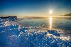 Ice floes floating on the fog water in the lake Baikal and hill. Sunset. Ice floes floating on the fog water in the lake Baikal and hill, Russia. Sunset Stock Images