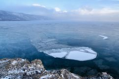 Ice floes floating on the fog water in the lake Baikal. Sunset. Ice floes floating on the fog water in the lake Baikal, Russia. Sunset Royalty Free Stock Image